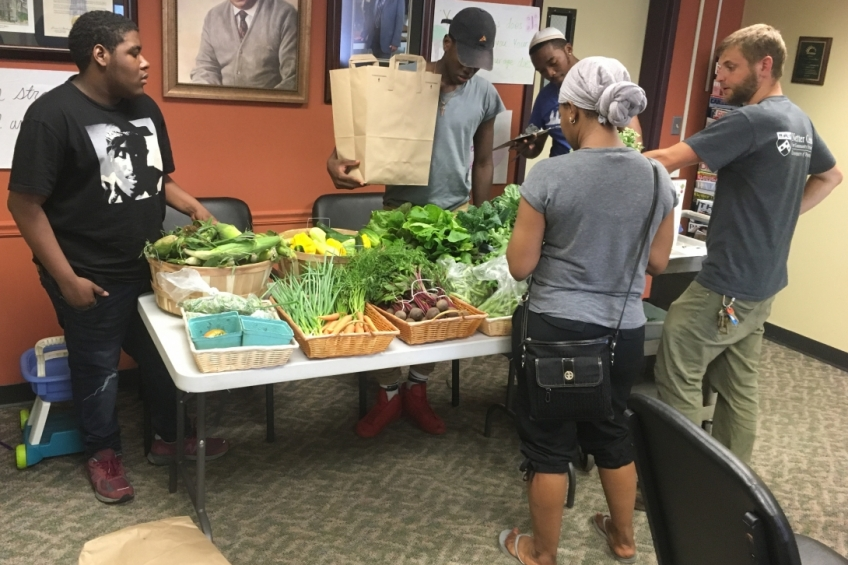 AUNI CSA Nutrition Educator Eric Sherman and students prepare for Good Food Bag pick-ups.
