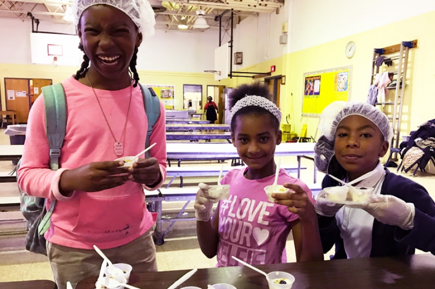 Comegys Elementary students are all smiles during AUNI's 5th Grade Lunch Club.